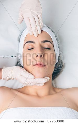 Closeup of woman getting cosmetic injection in the face