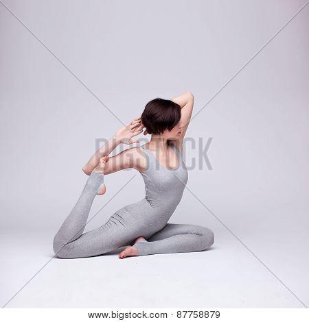 young beautiful woman yoga posing