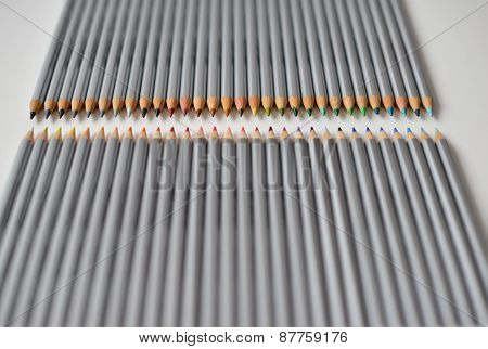 Colorful Wooden Pencils Lying In A Row Isolated On White Background