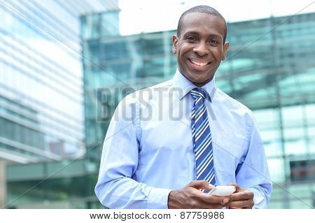 Smilinh Businessman With Mobile Phone