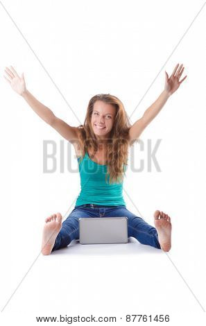 Pretty girl using laptop isolated on white