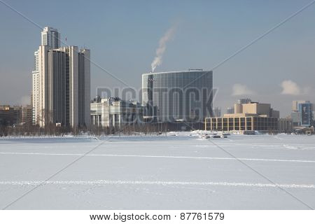YEKATERINBURG, RUSSIA - FEBRUARY 20, 2011: Hayat Hotel and the buildings of the Sverdlovsk regional government of the embankment of the City Pond in Yekaterinburg, Russia.