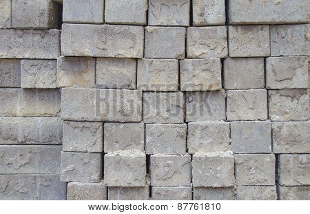 Grey bricks stacked in rows