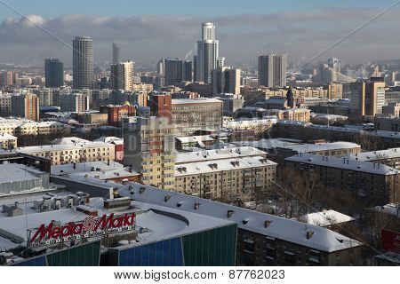YEKATERINBURG, RUSSIA - FEBRUARY 22, 2011: Panoramic view with modern skyscrapers and Soviet era dwelling blocks in Yekaterinburg, Russia.