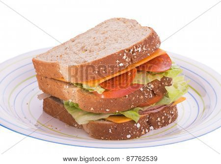 Triple decker sandwich on a plate