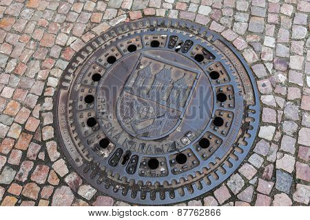 Manhole with the emblem of Prague in the historic city center