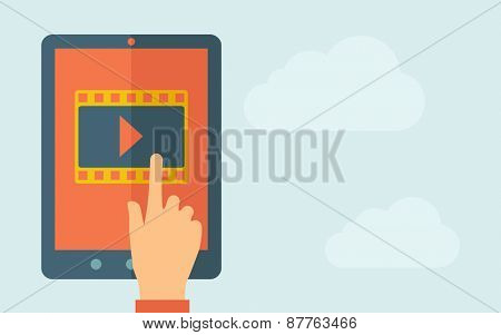 A hand is touching the screen of a tablet with film icon. A contemporary style with pastel palette, light blue cloudy sky background. Vector flat design illustration. Horizontal layout with text space
