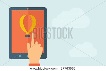 A hand is touching the screen of a tablet with air balloon icon. A contemporary style with pastel palette, light blue cloudy sky background. Vector flat design illustration. Horizontal layout with