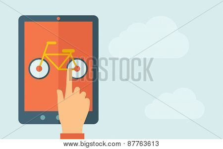 A hand is touching the screen of a tablet with bicycle icon. A contemporary style with pastel palette, light blue cloudy sky background. Vector flat design illustration. Horizontal layout with text