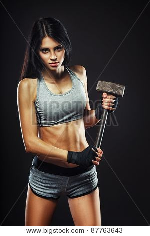 Beautiful woman with a big hammer