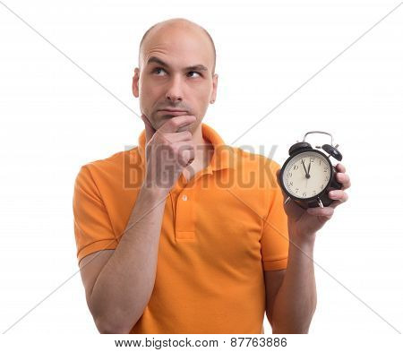 Bald Man Holding An Alarm Clock And Thinking