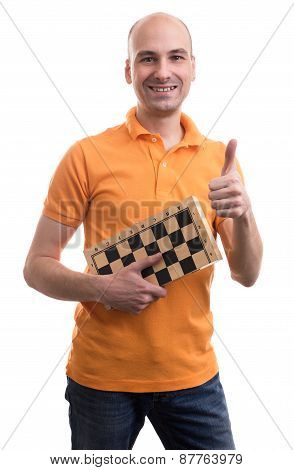 Bald Man Holding A Chess Board