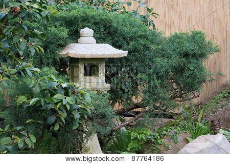 Stone Lantern Made Of Granite In A Asian Garden