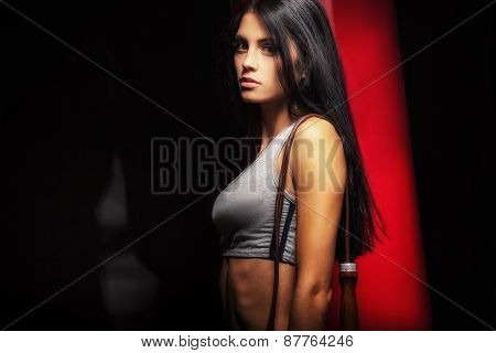 woman boxer near red punching bag