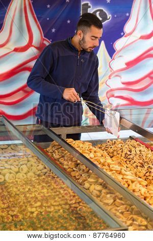 MARSAXLOKK, MALTA - JANUARY 11, 2015: biscuit and cookie salesman at Marsaxlokk market, one of the city's main features especially on Sunday.