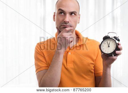 Handsome Man Holding An Alarm Clock