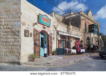MARSAXLOKK, MALTA - JANUARY 11, 2015: People sitting at Terrone restaurant terrace.