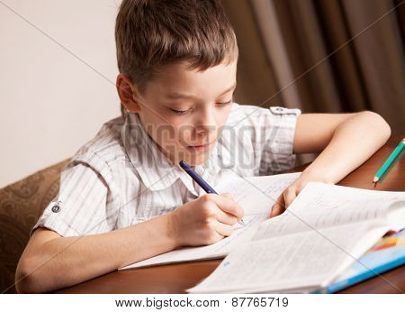 Boy doing homework. Child education