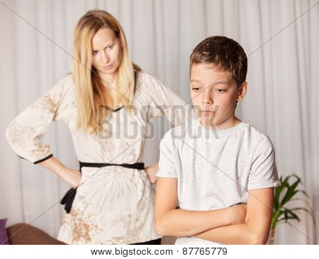 Mom swears by son. Conflict, problems in family. Sad mother and child
