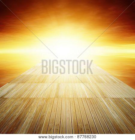 Wooden floor leading to sky