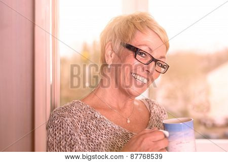 Vivacious Middle-aged Woman Drinking Coffee