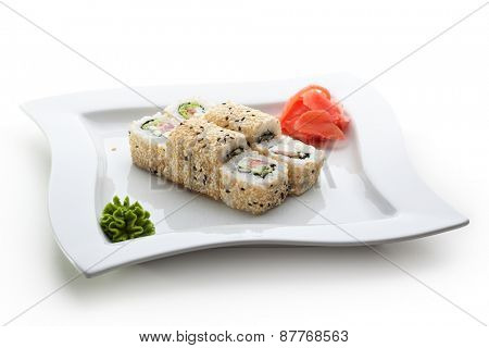 Maki Sushi - Roll made of Smoked Salmon, Cream Cheese, Cucumber and Spring Onion inside. Sesame ouside
