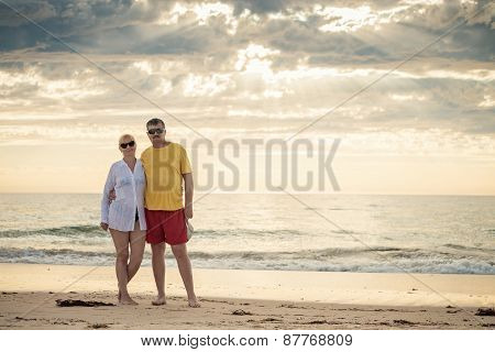 Happy mature couple in mid fifties at the beach