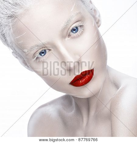 Beautiful girl in the image of albino with red lips and white eyes. Art beauty face.