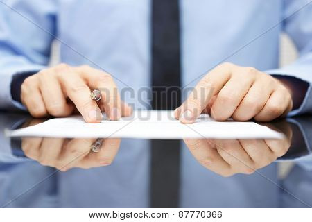 businessman is carefully reading contract