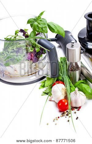 Blender with fresh vegetables and herbs