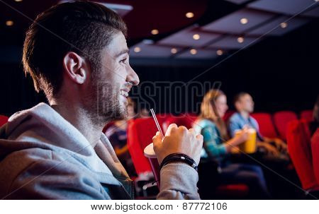 People watching a film at the cinema