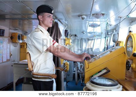 SEVASTOPOL, CRIMEA, UKRAINE - AUGUST 17, 2012: Midshipman on the bridge of Russian frigate