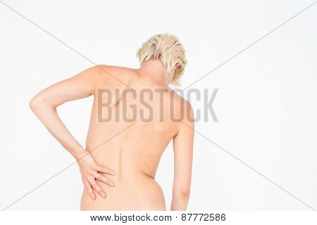 Beautiful woman with back pain on white background