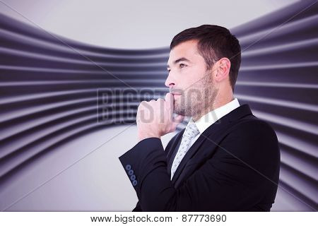 Frowning businessman thinking against abstract room