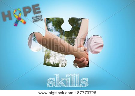 The word skills and autism awareness month against blue background with vignette