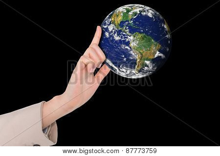 Businesswoman pointing against planet earth