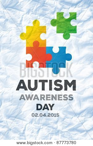 Autism awareness day against crumpled white page