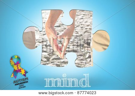 The word mind and happy senior couple touching hands against blue background with vignette