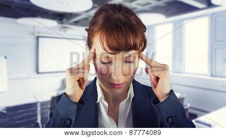 Stressed businesswoman against classroom