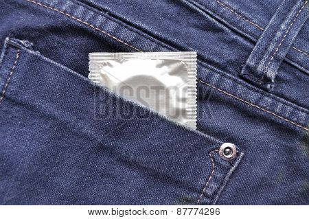 Condom in the blue jeans pocket