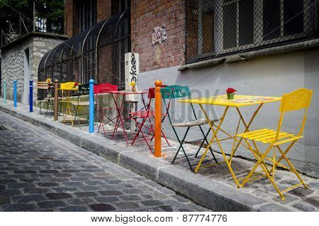 Tables And Chairs On The Pavement