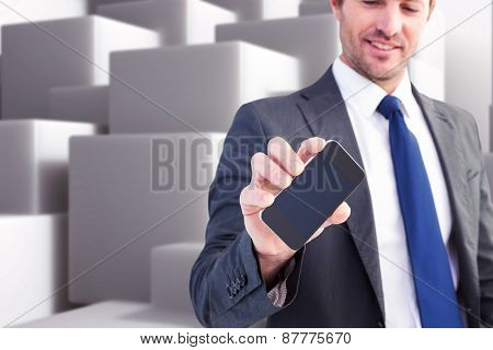 Businessman showing his smartphone screen against abstract white design