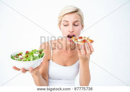 Pretty woman deciding eating pizza rather the salad on white background