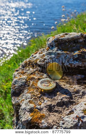 Compass Abandoned On The Rocks
