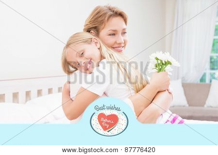 mothers day greeting against mother and daughter hugging with flowers