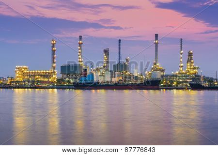 Oil refinery industry plant during twilight