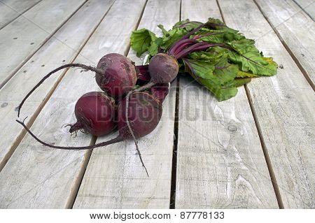 Beetroot Bunch On White Wood