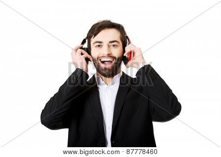 Businessman with headphones listening to music.