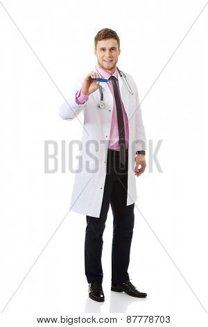 Handsome male doctor holding a thermometer.
