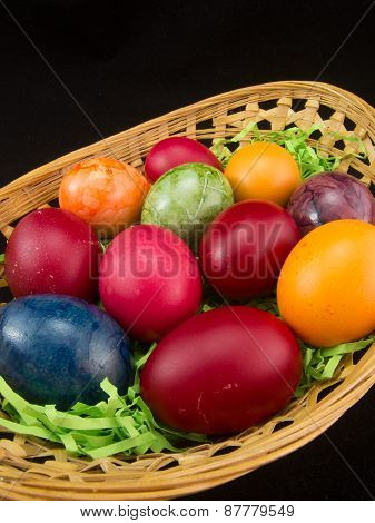 multicolor easter eggs in basket